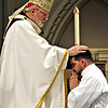 Cardinal Sean O'Malley places his hand on candidate Mr. Marcos Enrique during the Rite of Ordination. SUN/ David H. Brow