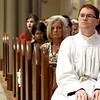 Deacon candidate Mr. Carignan Langlois Rouse listens to Cardinal Sean O'Malley during the Rite of Ordination ceremony. SUN/ David H. Brow