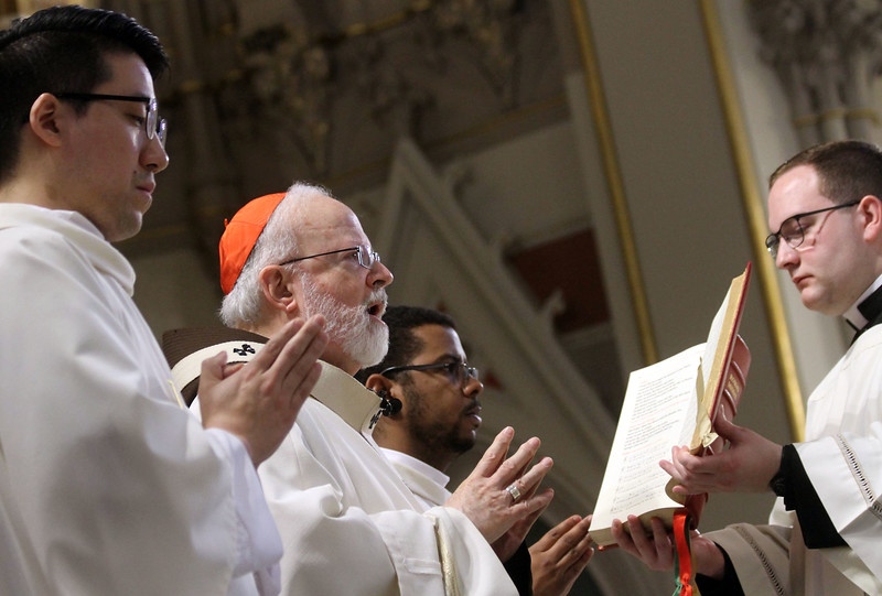 Cardinal Sean O'Malley conducts the Rite of Ordination for new Deacons. SUN/ David H. Brow