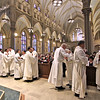 The new Deacons are greeted byVesting Clergy after the Rite of Ordination ceremony. SUN/ David H. Brow