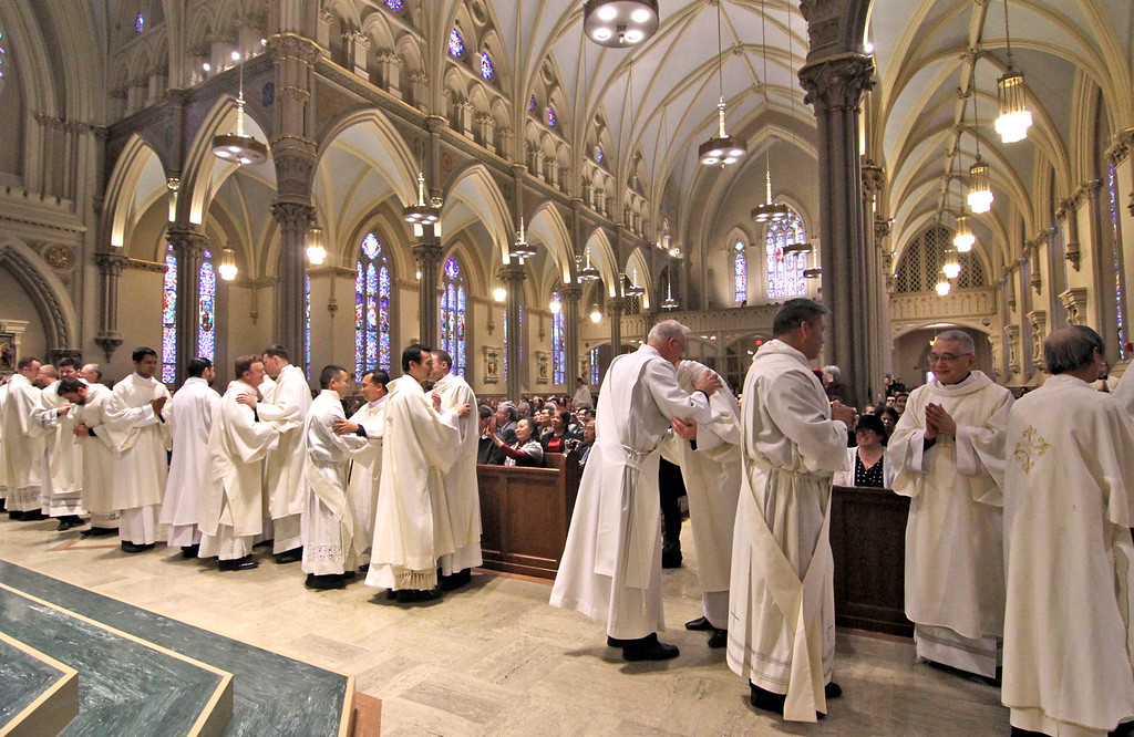 . The new Deacons are greeted byVesting Clergy after the Rite of Ordination ceremony. SUN/ David H. Brow