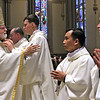Cardinal Sean O'Malley meets and greets the new Deacons after the ordination ceremony. SUN/ David H. Brow