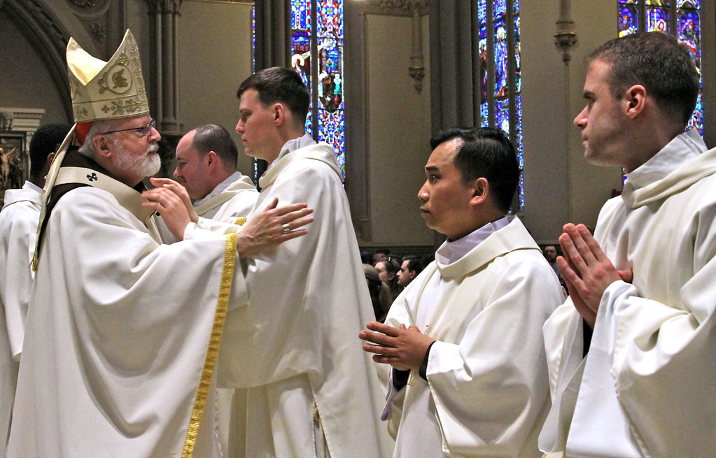 . Cardinal Sean O\'Malley meets and greets the new Deacons after the ordination ceremony. SUN/ David H. Brow
