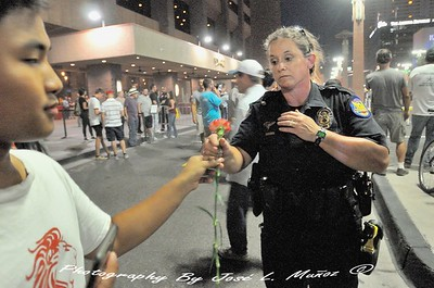 Anti - Trump  Protestor Gives Flower to Phoenix Police Officer After the Rally