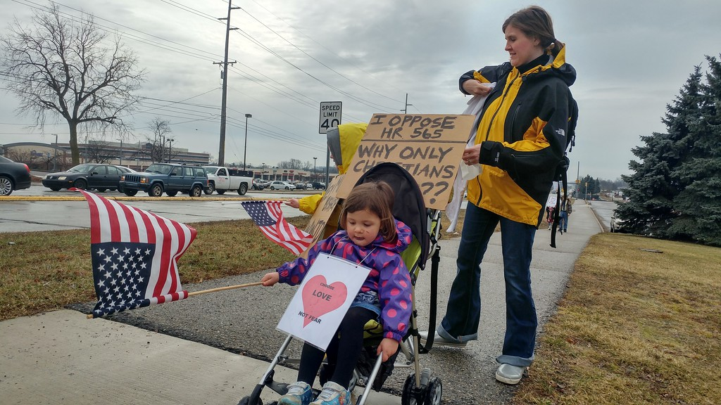 . Demonstrators protesting House Resolution-565, or the �Save Christians from Genocide Act�, co-sponsored by Rep. Mike Bishop while asking for Bishop to hold a town hall with his constituents, outside of Rochester High School in Rochester Hills on Tuesday, Feb. 21, 2017.