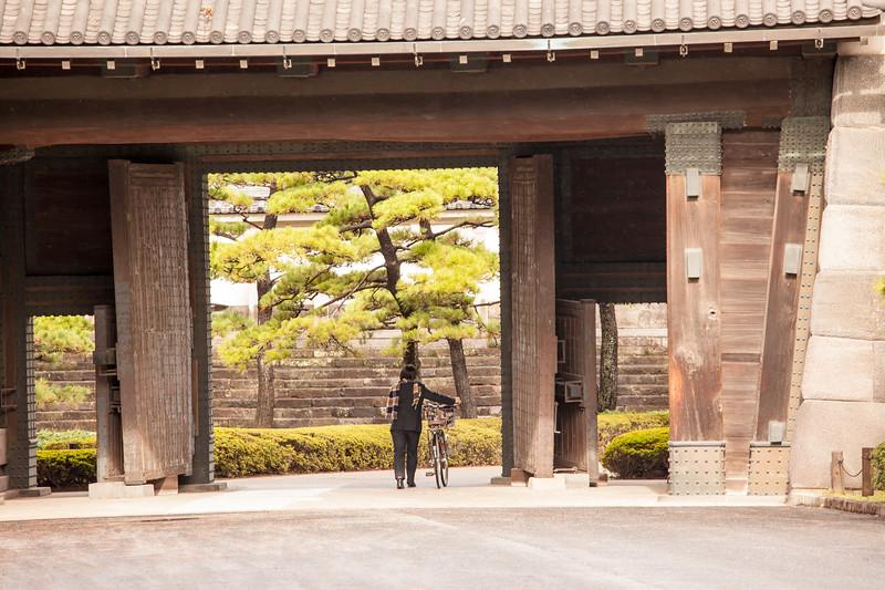 Woman with bicycle at Hirakawa-mon