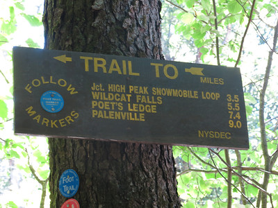 Hike the blue/red trail for about 1 mile before you get to Huckleberry Point yellow trail markers.