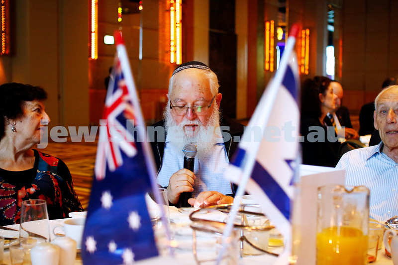 Straight between the flags. Rabbi Philip Heilbrunn reciting birkat hamazon at the annual Caulfield Hebrew Congregation Yom Ha'atzmaut breakfast at Crown Palladium. Photo: Peter Haskin