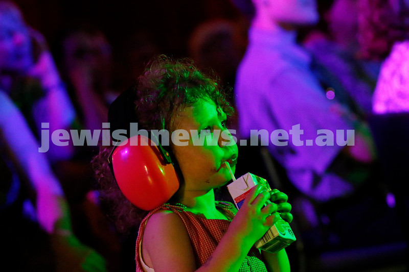 Captivated and content. With headphones making sure delicate ears were protected this little girl happily sipped away on her juice and enjoyed the sights and sounds of the Amy Winehouse tribute show at Memo Music Hall. Photo: Peter Haskin