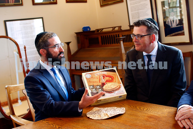 26-3-18. With Pesach starting this week, Rabbi Rabbi Yaakov Glasman explains the significance of the shmurah matzah to Vicrorian Premier Daniel Andrews during his visit to St Kilda shul. Photo: Peter Haskin