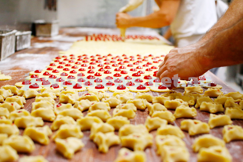 Yummmm!! It's Purim, well, almost. Getting themselves ready for next weeks hamantashen onslaught, the Aviv Bakery is hard at work preparing row after of those delicious little ears that we just can't get enough of. Photo: Peter Haskin