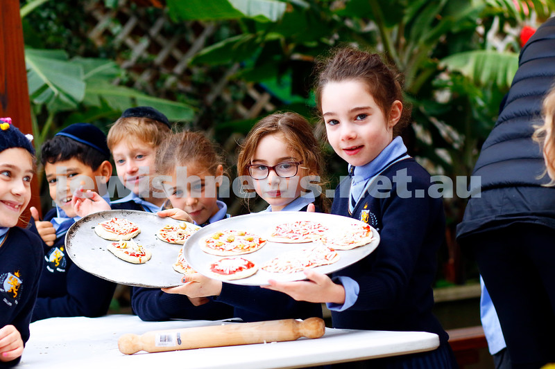 It's Shavuot time. Year one students at Mt Scopus Gandel Besen House proudly show off their special Shavuot cheese pizzas, all ready for the oven. Photo: Peter Haskin