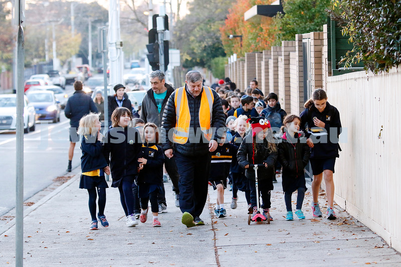 With the sun just having risen and a chilly 4 degrees, more than 120 primary students from Leibler Yavneh College head off on National Walk to School Safely Day. Photo: Peter Haskin