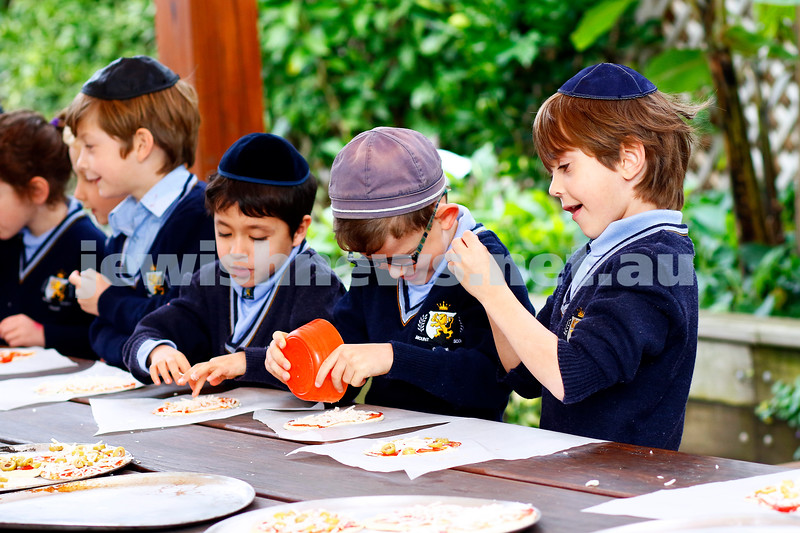 It's Shavuot time. Year 1 Mt Scopus Gandel Besen House students put the finishing touches on their special Shavuot cheese pizzas. Photo: Peter Haskin