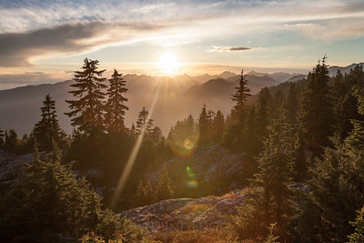 The sun sets over the Coast Mountain Range near Vancouver, British Columbia.