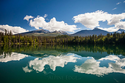 The Caribou Mountain Range is reflected in Unna Lake in Bowron Lake Provincial Park