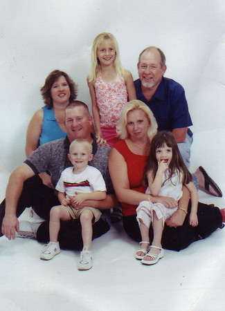 Jim's son James Jr., grandson and grandchildren.