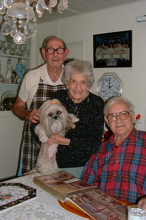 Grandpa Jim, grandma Rose (with my dog Pumpkin) & Orlando, my dad. They are all deceased now (except for my dog). I miss them so much.