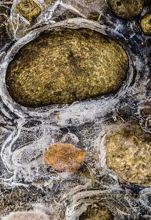 Rocks in ice in stream at Blandford Ski Area in Massachusetts