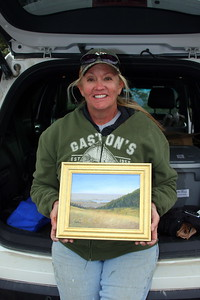 "Debra Jeffrey, with her work, ""View From The Meadow."""