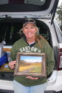 "Debra Jeffrey, with her work, ""Coyote Trail."""