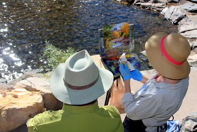 Cheryl St. John, Artist, discusses her work with a fan, Clear Creek