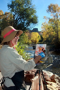 Cheryl St. John, Artist, at her easel, Clear Creek