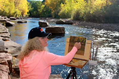 Janiece Linden, Artist, at her easel, Clear Creek