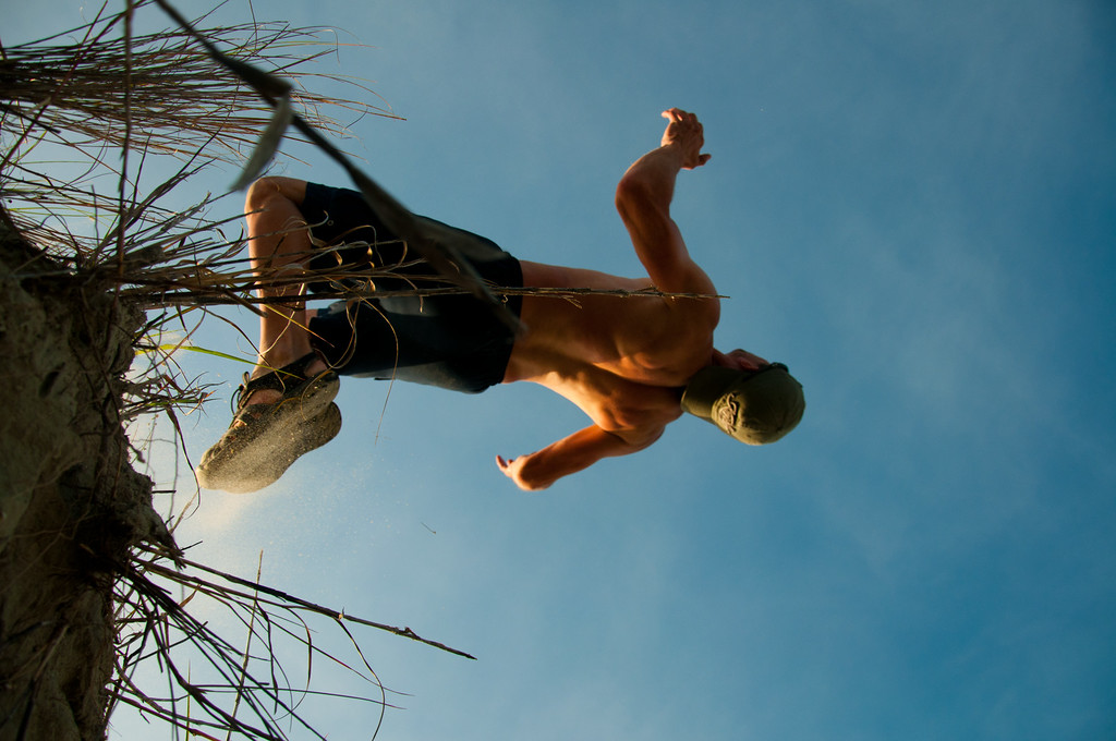 Backflip fun off of a sand dune. Photo by Chris Miller.
