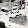 "Fina gas station and possibly car sales. This card does not have a caption but a handwritten note on the reverse says ""Caryl Baker, from Mille Roche, corner of power dam and Hwy 2  intersection.""<br /> —Clive Marin Collection"
