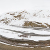 The Spiti River winds through snow covered peaks