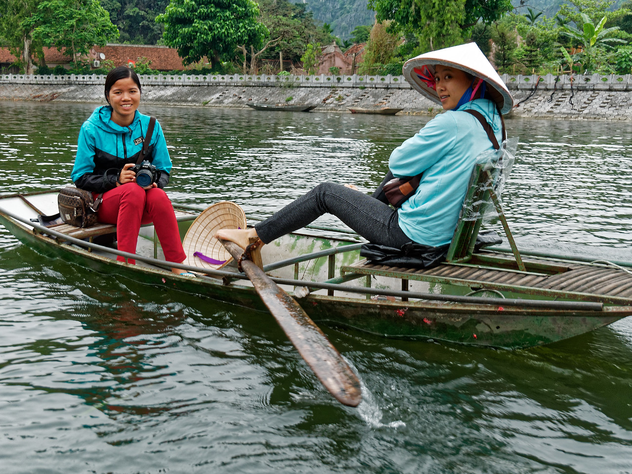 Most of the boats are rowed by women, who do so using their feet and legs.