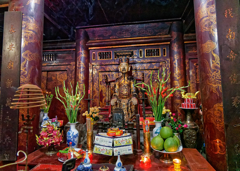 Image and altar with offerings honoring Dinh Tien Hoang