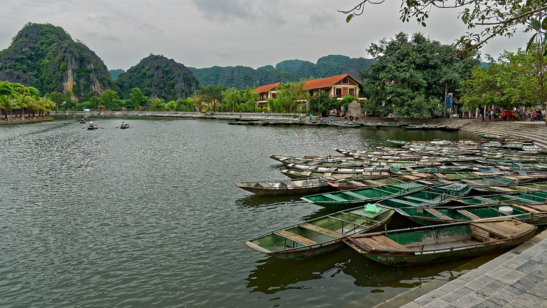 From the village of Truong Yen boats carry visitors through a scenic landscape along the Hoang Long River.