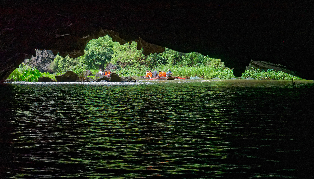 One of three caves that the river has carved out of the limestone mountains