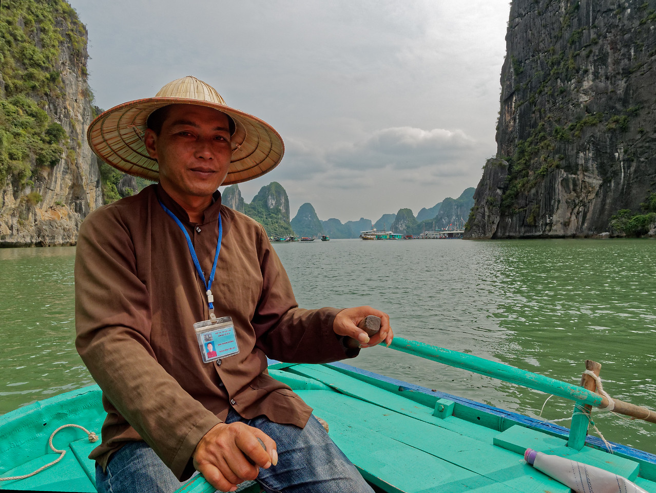 Our boatman, who guided us through several of the bay's caves