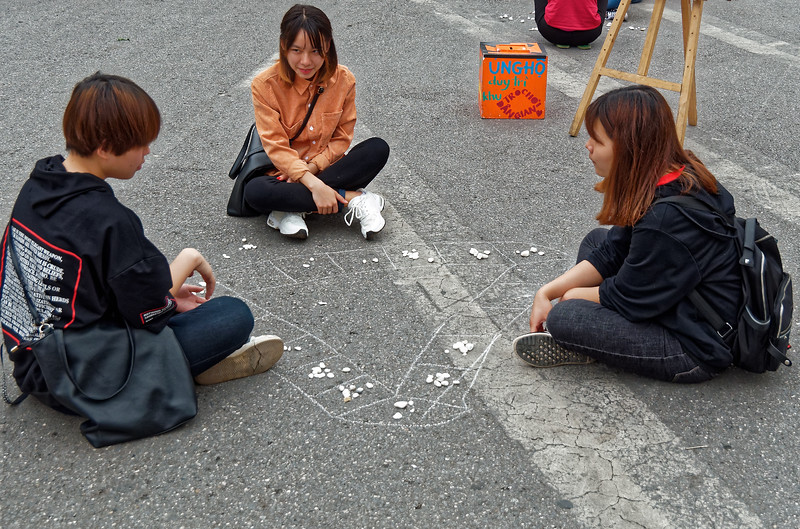 A broad thoroughfare near Hoan Kiem Lake was closed to traffic, allowing many groups of youngsters to take advantage of the space to play games.