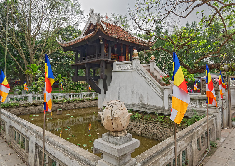 The One Pillar Pagoda was built between 1028 and 1054 and restored after the departing French partially destroyed it in 1955. The small wooden structure sitting atop a single concrete (originally stone) base was meant to resemble a lotus flower rising from the lotus pond in which it is sited.
