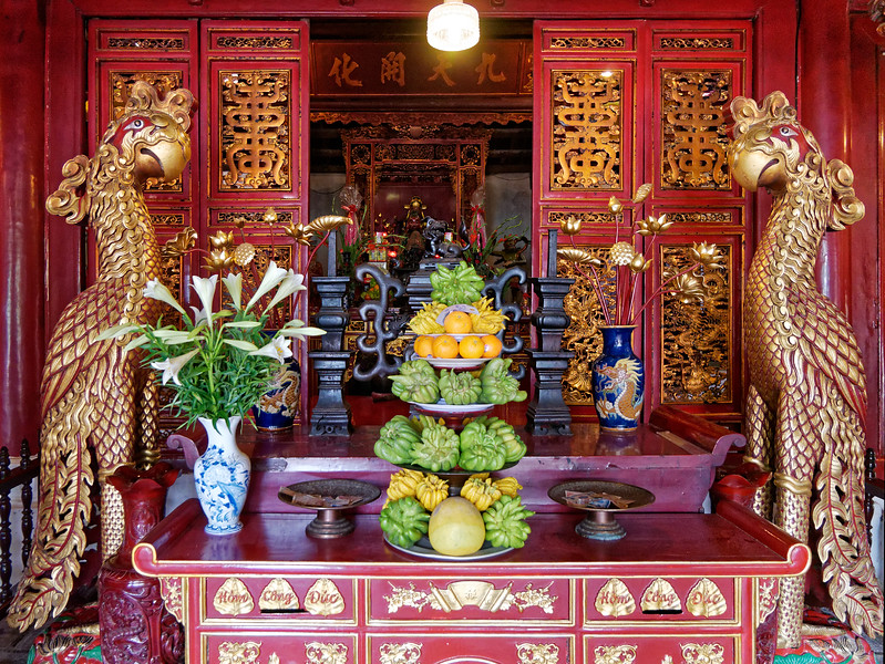 In the background, an altar at Ngoc Son Temple