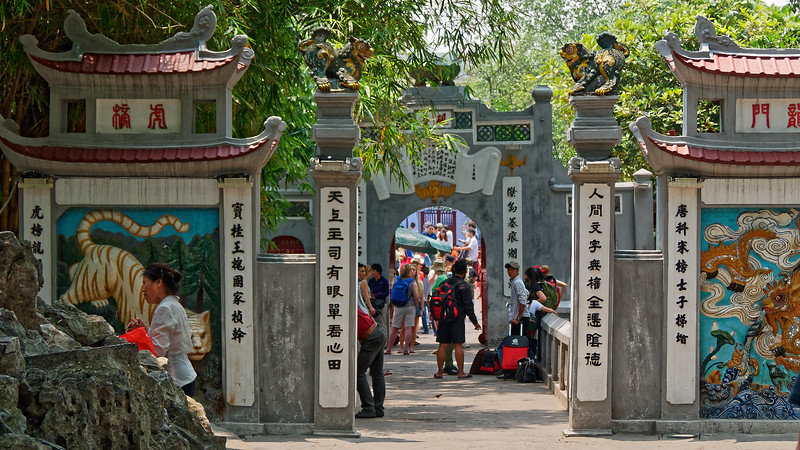 The main entrance to Ngoc Son Temple, reached via a wooden bridge that spans the water of Hoan Kien Lake