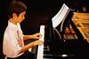 Boy Playing Piano at Recital July 2001
