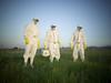 men white suits field