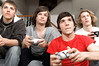 teens 4 boys play videogame