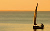 Traditional sail boat called a dhow at sunset, Vilanculos coastal sanctuary, Mozambique