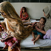 Sick Pakistani children share a bed at the District Headquarters Hospital in flood affected Muzaffargarh district, Punjab province, Pakistan, Tuesday, Aug. 24, 2010. Pakistan's medical system has been badly hit by weeks of flooding, with hundreds of health facilities damaged and tens of thousands of medical workers displaced, the prime minister said Tuesday as the country braced for the spread of disease. (AP Photo/Aaron Favila)