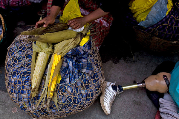 APTOPIX Guatemala Saint(2).JPG A woman sells corncobs next to an artificial leg during Saint Bartolome Day celebrations in San Bartolome Milpas Altas, some 35 km west of Guatemala city, Tuesday, Aug. 24, 2010. (AP Photo/Rodrigo Abd)