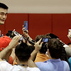 Houston Rockets center Yao Ming, left, of China, talks to reporters after a basketball workout Tuesday, Aug. 24, 2010 in Houston. Yao underwent a medical evaluation Monday which revealed the hairline fracture in his surgically repaired left foot has fully healed. He has been cleared to take part in normal basketball activities. (AP Photo/David J. Phillip)