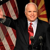 Sen. John McCain, R-Ariz., left, waves to supporters at an election victory party with his wife Cindy McCain, Tuesday, Aug. 24, 2010, in Phoenix.  In McCain's toughest Republican election primary in years, beating former congressman J.D. Hayworth. (AP Photo/Ross D. Franklin)