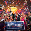 Surrounded by family, Republican gubernatorial candidate Rick Scott celebrates with supporters Tuesday, Aug. 24, 2010, in Fort Lauderdale, Fla. Florida's Republican voters chose Scott over career public servant Bill McCollum as their candidate for governor. (AP Photo/Wilfredo Lee)
