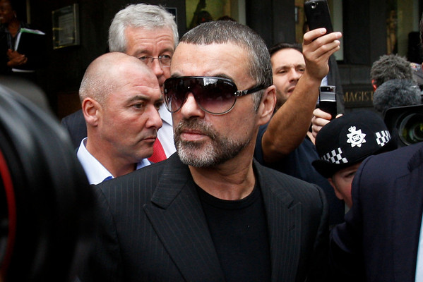 British singer George Michael leaves Highbury Corner Magistrates Court in north London, Tuesday, Aug. 24, 2010. Singer George Michael has pleaded guilty in a London court to two drug offenses. He admitted driving under the influence of drugs and possession of cannabis following an incident on July 4 when his car crashed into a shop in north London. (AP Photo/Sang Tan)